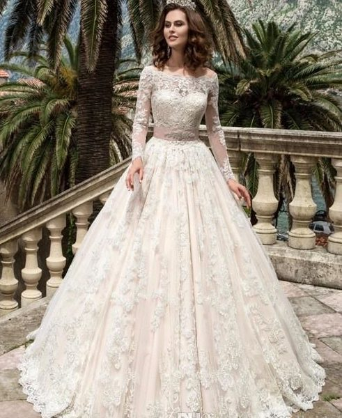 vestido de novia corte princesa con manga